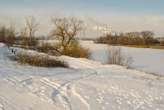 Late afternoon winter landscape with frozen river Stock Images