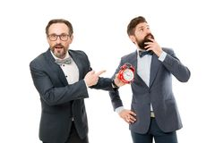 Late again. angry businessmen. bad morning. a lot of work. time management. mature bearded men in formal suit hold alarm. Clock. deadline. on ho. rush hour royalty free stock photo