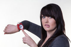 Late again. Woman looking at here wrist watch late for a something stock images