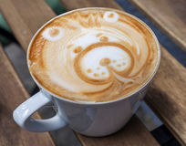 Late Art made in coffee shop, beautiful happy bear on table Stock Photography