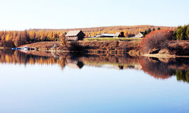Late Autumn. Herdsman`s cottage nearby a lake Royalty Free Stock Photos