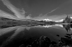 A Late Autumn Lake McDonald Reflection In Black And White Stock Photography