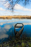 Late autumn landscape. With half-sunken boat on the river Stock Photo