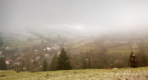 Late autumn misty morning in a village. First Snow Royalty Free Stock Photo