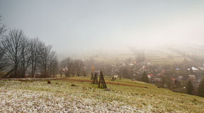 Late autumn misty morning in a village. First Snow Stock Photography