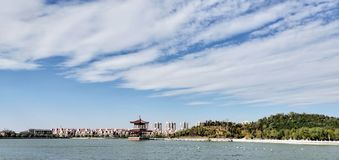 Tianjin city scenery,some citizens are rowing in the lake. In the late autumn season, on a sunny day, the citizens are boating for their weekend stock image