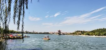 Tianjin city scenery,some citizens are rowing in the lake. In the late autumn season, on a sunny day, the citizens are boating for their weekend stock photography