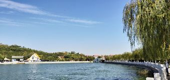 Tianjin city scenery,some citizens are rowing in the lake. In the late autumn season, on a sunny day, the citizens are boating for their weekend stock photo