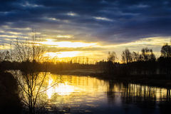 Late Autumn Sunrise. A beautiful sunrise by the river in the Northern Finland stock image
