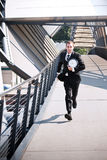 Late caucasian businessman in a rush. A late caucasian businessman running in a rush Royalty Free Stock Photography