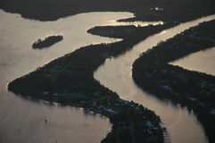 Late day delta. Aerial of light reflecting from lake and river Stock Photos