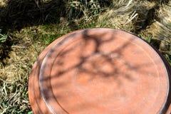 Upside Down Birdbath Shadows. Late day sunlight making shadows on upside down birdbath in garden Stock Images
