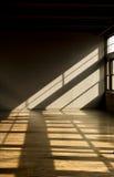Late day window light streaming thru windows into Stock Image