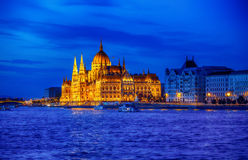 Late evening illumination of hungarian parliament in budapest Royalty Free Stock Photos