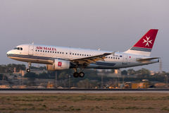 Late evening landing. Luqa, Malta 23 July 2008: Air Malta Airbus A319-111 landing runway 32 in the last rays of the day royalty free stock photos