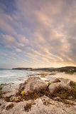 Late evening landscape of ocean over rocky shore heavy clouds bl Royalty Free Stock Images