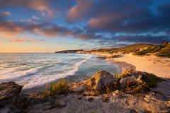 Late evening landscape of ocean over rocky shore heavy clouds bl Royalty Free Stock Photography