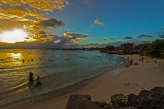 Late evening at Oistins beach on Barbados South Coast with the calm blue waters of the Caribbean Sea. Stock Images