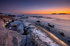 Late evening seascape. With salt colored rock Stock Images