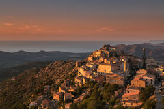 Late evening sunshine on mountain village of Speloncato in Corsi Stock Photography