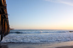 Late evening surf next to Ventura Wooden Pier, CA Royalty Free Stock Image