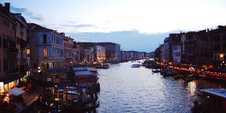 Late evening in Venice. Grand Canal tourist boats. Stock Photography