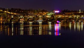 Free Late Evening View Of Charles Bridge Over Vltava River, Prague, Czech Republic. City Lights Reflecting On Water Surface. Stock Photos - 187496233
