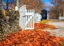 Late fall in Kentucky. Stone fence with white wooden gates in Shaker Village of Pleasant Hill, Kentucky Royalty Free Stock Photography