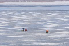 Late fishing on the Oka ice. Ice melts and there is open water on it. Stock Photography