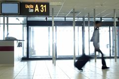 Late at the Gate. Man walking fast to reach his gate at the airport Stock Photos