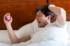 Late man in bed. After awakening, horizontal Royalty Free Stock Image