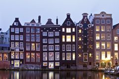 Late medieval houses in Amsterdam Netherlands. Late medieval houses in Amsterdam by twilight in the Netherlands Royalty Free Stock Images