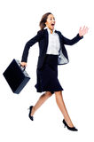 Late for a meeting. Businesswoman in a hurry rushing and running with briefcase isolated on white background Stock Photography