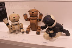 Late model Sony Aibo Robot Dogs on Display. A group of Sony Aibo robot dogs displayed at an exhibition held at the Sony Building in Ginza, Tokyo. Photo taken Royalty Free Stock Photo