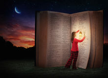 Late night Bible Study. A woman studying the Bible late at night Royalty Free Stock Photos