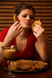 Late Night Binge. Young lady having a late night binge of cookies and milk stock photography