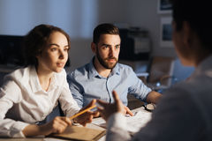 Late Night Discussion at Meeting Table Stock Images