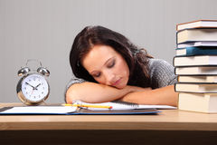 Late night homework woman falls asleep at desk Stock Image