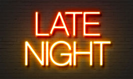 Late night neon sign on brick wall background. Stock Images