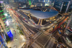 Late night traffic blurs past Dongdaemun Design Plaza,Seoul City Stock Photos