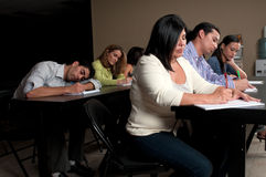 Late night training. Student falling asleep during a night class training in a corporate classroom Stock Image