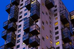 Late night view of council flats. Exterior of complex building i. N the city royalty free stock image