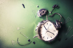 Late for school concept with alram clock on a blackboard Stock Photos