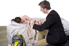 Late For School. Father waking up lazy daughter for school Royalty Free Stock Photo