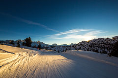 Late on the ski slope. The sunset in the last ski slope of the day Stock Photography