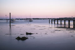 Late Summer evening landscape across harbor long exposure with j Stock Photo