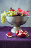 Late summer fruits. Still life in a pewter bowel Royalty Free Stock Photos