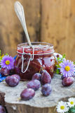 Late summer kitchen jar plum jam Royalty Free Stock Photos