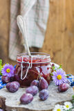 Late summer kitchen jar plum jam Royalty Free Stock Photography
