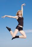 Late teenage girl is dancing outdoors Stock Photos